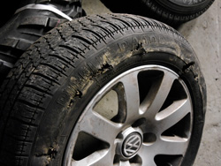 A damaged tyre on an alloy wheel